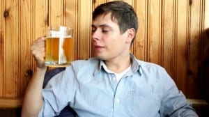 stock-footage-young-man-drinking-cold-beer