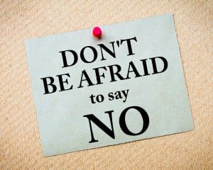 Don't Be Afraid To Say NO Message written on recycled paper note pinned on cork board. Motivational concept Image