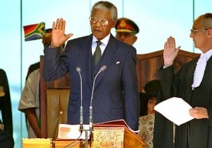 Mandela is sworn into office as president by South African Chief Justice Michael Corbett in Pretoria.