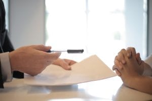 crop-businessman-giving-contract-to-woman-to-sign-3760067
