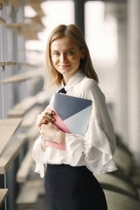 smiling-woman-with-notebook-in-office-hall-4173256