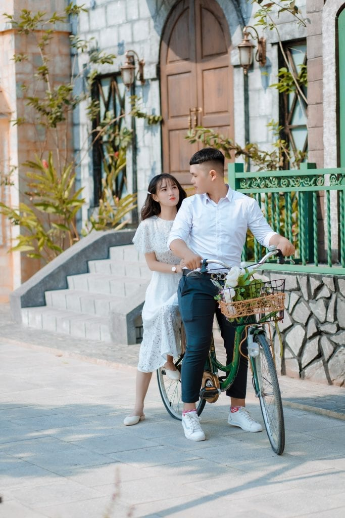 man-and-woman-riding-green-bicycle-3690665