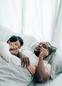 sleeping-ethnic-woman-embracing-black-husband-lying-and-4545208