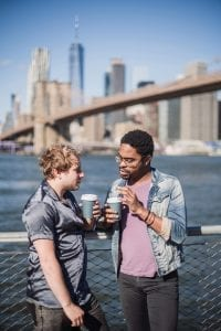 two-men-standing-outside-with-paper-cups-4657722